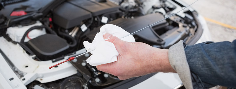 Mechanic cleaing the dipstick - Car Servicing Stockport