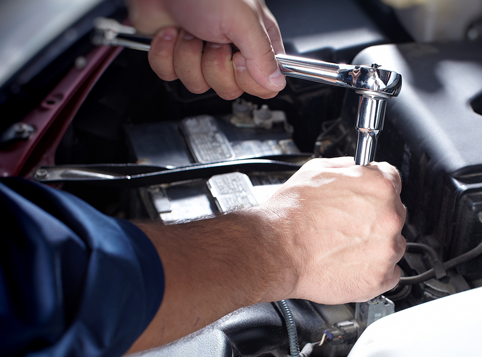 Mechanic looking at a car engine - Car Repairs Stockport